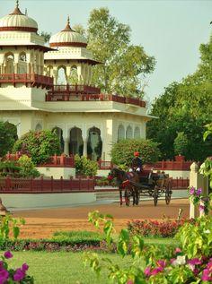 Horse-carriage tour of grounds awaits guests at Taj Rambagh Palace Hotel, Jaipur, Rajasthan, India.