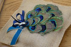 We love this unique peacock ring bearer pillow #wedding #rings #ringbearer #pillow #peacock