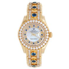 Rolex Lady's Yellow Gold Pearlmaster Mother Of Pearl Myriad Sapphire Wristwatch | See more rare vintage Wrist Watches at http://www.1stdibs.com/jewelry/watches/wrist-watches