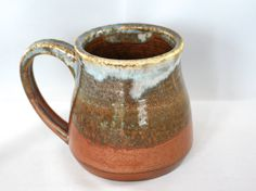 Large (12oz) stoneware pottery mug, with lustrous copper glaze and light blue highlights, sun impression stamp on handle by CenteredVessel on Etsy