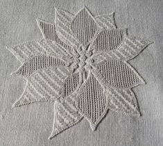 """Satin stitches in connection with other drawn thread patterns (here: filling pattern """"Netz"""" from my book """"Limetrosen I"""", page 6) can be very attractive, as seen here in the leaves of the poinsettia bloom. Luzine Happel"""