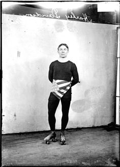 Roller skater Harley Davidson wearing roller skates and an American flag colored sash around his waist c. 1907. Photograph from the Chicago Daily News. SDN-005865 #chicago #history #holidays #july4 #american #flag