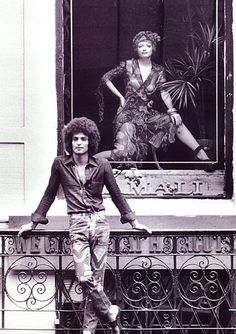 """This is from the late '60s in front of one of my early shops. I am in the window wearing a chiffon dress and head wrap. (Then husband) Eddie Kamali is wearing jeans that I hand painted for him."""