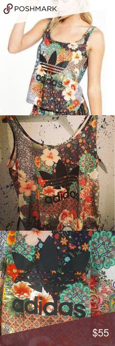 Adidas originals brazilian pattern tank Overlapping flowers and mandalas. Scoop neck and bottom,slightly hi-low. Absolutely beautiful. Wrong size for me and sold out. Could fit medium or large. adidas Tops Tank Tops