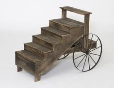 Amish Crafts Display Cart A unique, rustic style display cart great for plants and other decor. Made with solid wood. Choice of wood or metal wheels. #crafts #displaycart #rusticcart