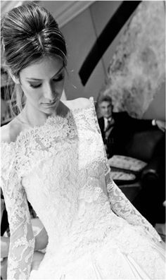 love the hint of bare shoulders on this vintage lace wedding dress