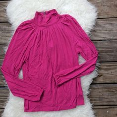 """Michael Kors Pink Turtleneck Excellent condition Michael Kors fuchsia turtleneck with zipper back with logo fob. Size Small. Stretchy rayon/spandex blend. Loose fitting 42"""" bust, total length is 24.5"""" long. No trades, offers welcome. MICHAEL Michael Kors Tops Tees - Long Sleeve"""