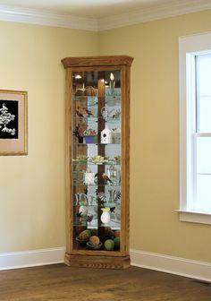 Found it at Clockway.com - Heartwood Malik Corner Curio Cabinet Classic Oak (Made in USA) - LHW3020