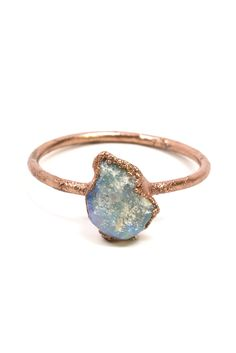 For centuries, Opals have been hailed as the most precious Empress of all stones. Arabic legends declare that it falls from the sky in flashes of lighting and perhaps it does to the Lightning Ridge mine in Australia. These stunning and unique stacking rings feature a raw Black Boulder Opal. The c...