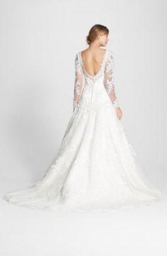 Long sleeved lace wedding dress