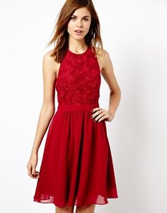 Warehouse Lace Bodice Floaty Dres in red. Soft woven fabric, crew neckline, lace bodice, fluid skirt with gentle pleating, at ASOS.