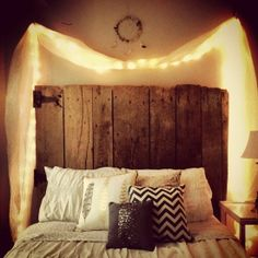 Love that old barn wood headboard!