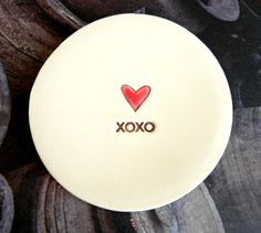 A personal favourite from my Etsy shop https://www.etsy.com/listing/120894765/ceramic-ring-dish-red-heart-xoxo