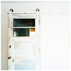 Door track hardware + funky old doors = giddy up and go go. Paint them white?!! That pretty much makes them my fave thing in the history of ever. It's all on lynneknowlton.com & it's d'bomb diggity. Just sayin' :sunglasses: