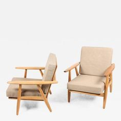 Pair of Lounge Chairs by Wegner by Hans  Wegner