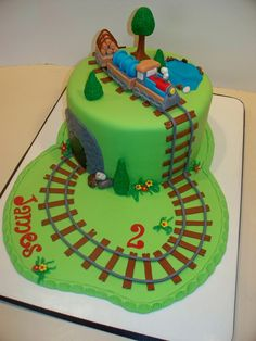 Train Birthday Cake Strawberry cake with cream cheese icing covered with fondant. All accents are fondant w/tylose. Thanks to many cake. Baby First Birthday Cake, 2nd Birthday, Birthday Ideas, Happy Birthday, Cake Original, Trains Birthday Party, Train Party, Thomas Cakes, Cake With Cream Cheese