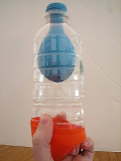 Model of a lung using a water bottle and two balloons. Lots of other great hands-on science activities on this blog.