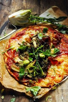 Rustic Pizza with thin homemade pizza dough, fresh vegetables and cheese.
