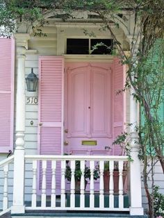 Pink Door and Shutters on an old white farmhouse