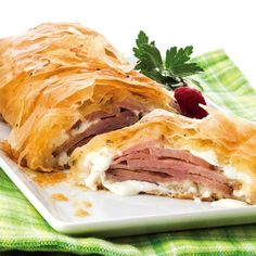 Flaky, buttery dough mixed with nutty Parrano cheese with the strong flavors of ham makes for the perfect Ham and Cheese Strudel