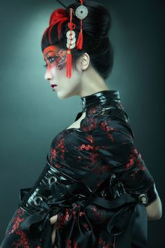 High fashion photography embellishing the modern Geisha style with intricate hair combs & stylish make -up.