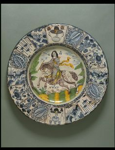 Dish, London. Date: 1680. Artist/Maker:  Unknown. Materials and Techniques:  Tin-glazed earthenware (Delftware), painted. VandA Collection.