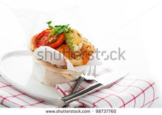 Fresh pizza muffin as a snack on white background as a studio shot - stock photo