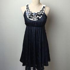 Fabulous embellished Milly dress Love the embellished neckline!  Silk patterned overlay over solid lining. Side zip. Fuller flirty skirt!  100% silk. Lining: 100% polyester Milly Dresses