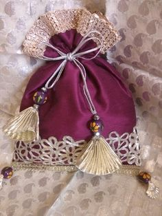 Purple rawsilk and silver lace potli bag!