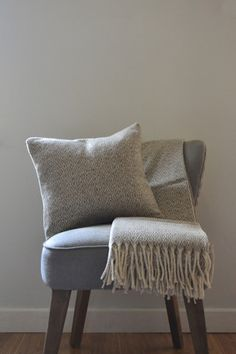 Lambswool cushion 'Ojos'. Delicate woven pattern inspired by indigenous designs.  Decorator's Notebook
