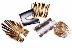 TOM FORD Starburst cuff, Giambattista Valli metal cuff, Tomas Maier brass bangle dipped in 24K gold , Hervé Van Der Straeten Mosaïque cuff in silvered brass, H. Stern Zephyr cuff