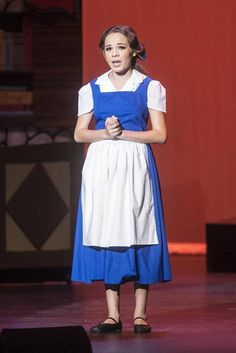 """Weaver seventh-grader Emerald Chandler plays the role of Belle during the Weaver Performing Arts production of """"Beauty and the Beast Jr."""" at the Merced Theatre in Merced, Calif., Tuesday, March 1, 2016. Cast and crew for the production consists of over 60 students from all three schools in the Weaver Union School District."""