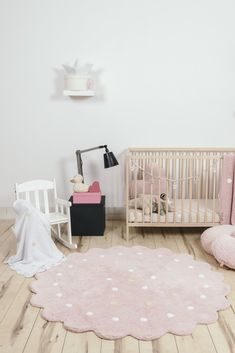 The Galletita Rug is the perfectly pink addition to a sweet baby girl nursery. Love the shape and scallop detail! #PNshop