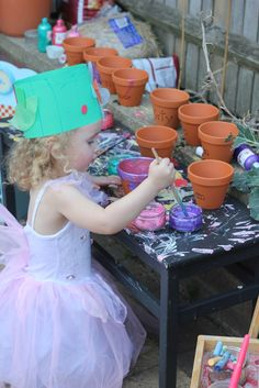 A garden flowers birthday party! - The Imagination Tree-A garden flowers birthday party! – The Imagination Tree Garden party for kids. Paint your own pot, plant seeds in it. Favor is mini water can with candy. Cake is little cupcakes in pots. Garden Party Favors, Garden Birthday, Flower Birthday, Birthday Cake, Birthday Crowns, Fairy Birthday Party, 7th Birthday, Fiestas Party, Luau Party