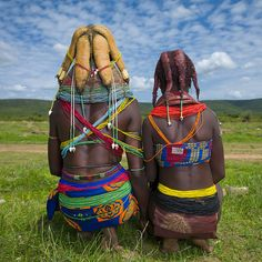 Africa | Mwila tribe women backs - Angola | On the left, she is married , she wears the beads necklaces, and on the right, her sister is not yet married, as she wears the big red necklace. | © Eric Lafforgue