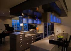 A kitchen with a light show at night. Soothing and exhilarating at the same time.
