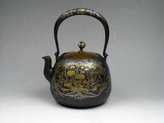 Approximately late 19th century, museum quality metal work, Japanese tetsubin teapot with exquisite and impressive gold and silver inlay work depicting beautiful floral motif and bird. It is excellent in condition. No repair, no cracks or chips, no leaking. This is the best of the best quality tetsubin teapot I have ever seen. Its quality is the highest and its condition is so excellent, and so I am very much confident to this museum quality masterpiece.