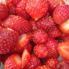 Organic strawberries fresh from the local farmers market. I see jam in their future...