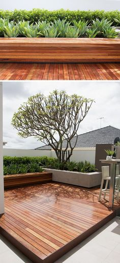 12 Ideas For Including Built-In Wood Planters In Your Outdoor Space // This wood planter is made from the same wood as the rest of the deck, but the lines run in the opposite direction. Using the same material makes it feel cohesive, but the lines running in a different direction signals that the planter is distinctly separate from the deck.