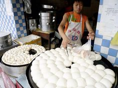 Breakfast in Chengdu. Steamed buns stuffed wif meat or vegetables, known as baozi, r a popular breakfast on de go_ China