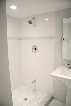 Inexpensive subway tile for most of shower, big impact with selective use of pricey accents. Love... with a marble hexagon floor
