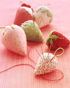 Charming strawberry pincushions are made with ribbon remnants, shirting fabric, and felt.