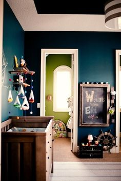 Emerald paint in room and bold lime paint in closet + chalkboard with toy basket