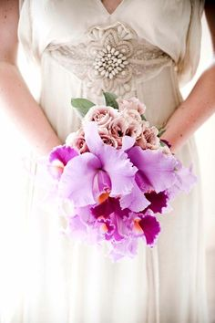 I love the contrast of this bouquet... traditional romantic meets modern exotic.