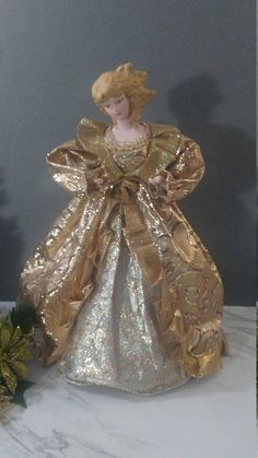 Beautiful Glamourous Tree Top Angel. Her hands and head are made of porcelain ceramic. The lights from the tree inside her and the reflection from the tree makes her shine like gold. Lovely. Medium to Large Size Measurements: Approximately 14 Inches Tall to the top of her head with Ghost Of Christmas Past, Christmas Tree Tops, Christmas Fairy, Christmas Items, Christmas Angels, Christmas Holidays, Xmas, Glamour Dolls, Vintage Glam
