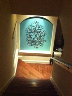 Bottom of stairs decor..Love the lights! Just may need to do this!