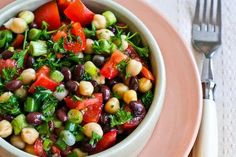 This Middle Eastern Bean Salad with Parsley and Lemon (Balela) makes a tasty lunch or side-dish salad any time of year. I love this with lots of parsley, but feel free to use less if you're not that big of a parsley fan. [from KalynsKitchen.com] #Vegan #GlutenFree