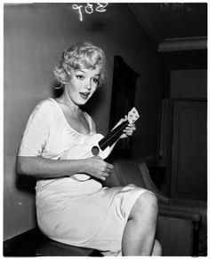 Marilyn Monroe playing the Ukelele, 1958 :: Los Angeles Examiner Collection, 1920-1961