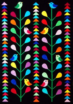 """Birds & Geese is a 35"""" x 48.5"""" wall hanging. The bird and flower applique pieces are made using lightweight fusible interfacing. Simply draw the desired shape on  fusible interfacing and then place on a piece of fabric. Sew on the drawn line and trim. Make a slit in the interfacing and flip the unit inside out and fuse to the background. All raw edges are turned under. No hand needlework required! From Happy Stash Quilts."""