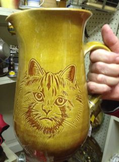 Sgraffito cat on large pitcher, by Sheldon Pottery